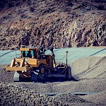 A bulldozer moves the preload on the heap leach pad at the Moss Mine.