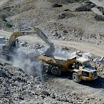 Moss Mine construction - Caterpillar With Rocks